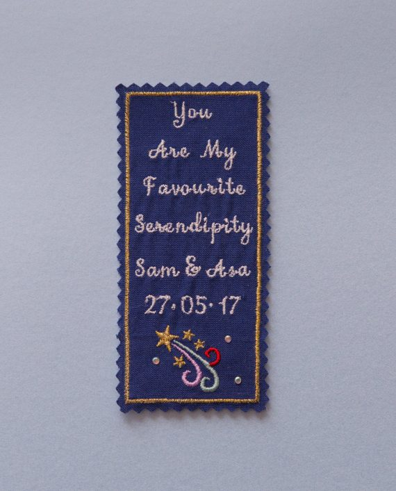 Embroidered personalised tie patch for a groom.